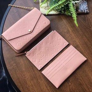 Louis Vuitton felicie empreinte crossbody pink